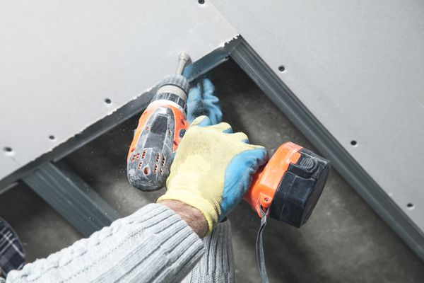 Screwing Drywall Into Place