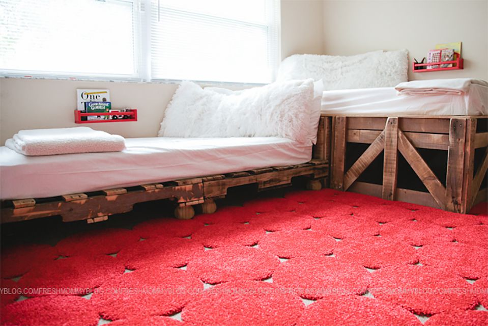 Two pallet beds on a red rug