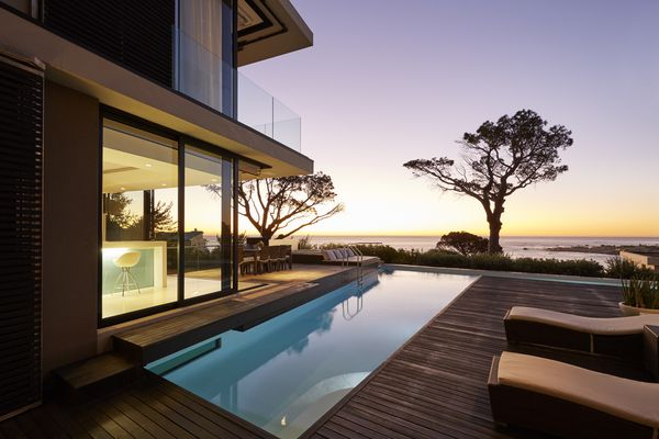 Patio and pool of a modern home at sunset