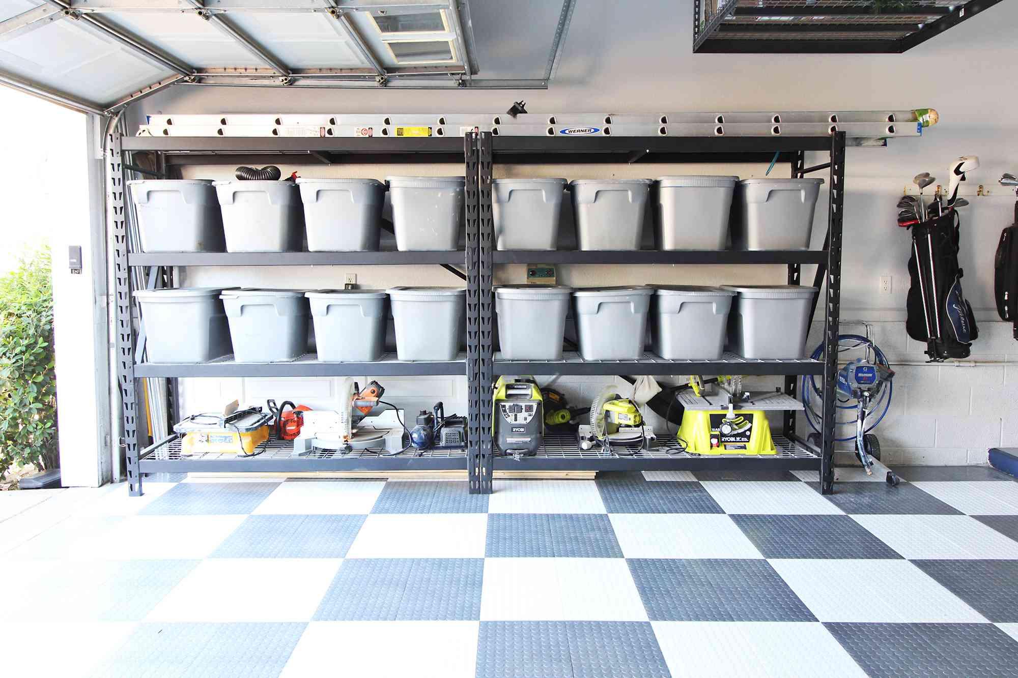 Tubs organized in a garage.