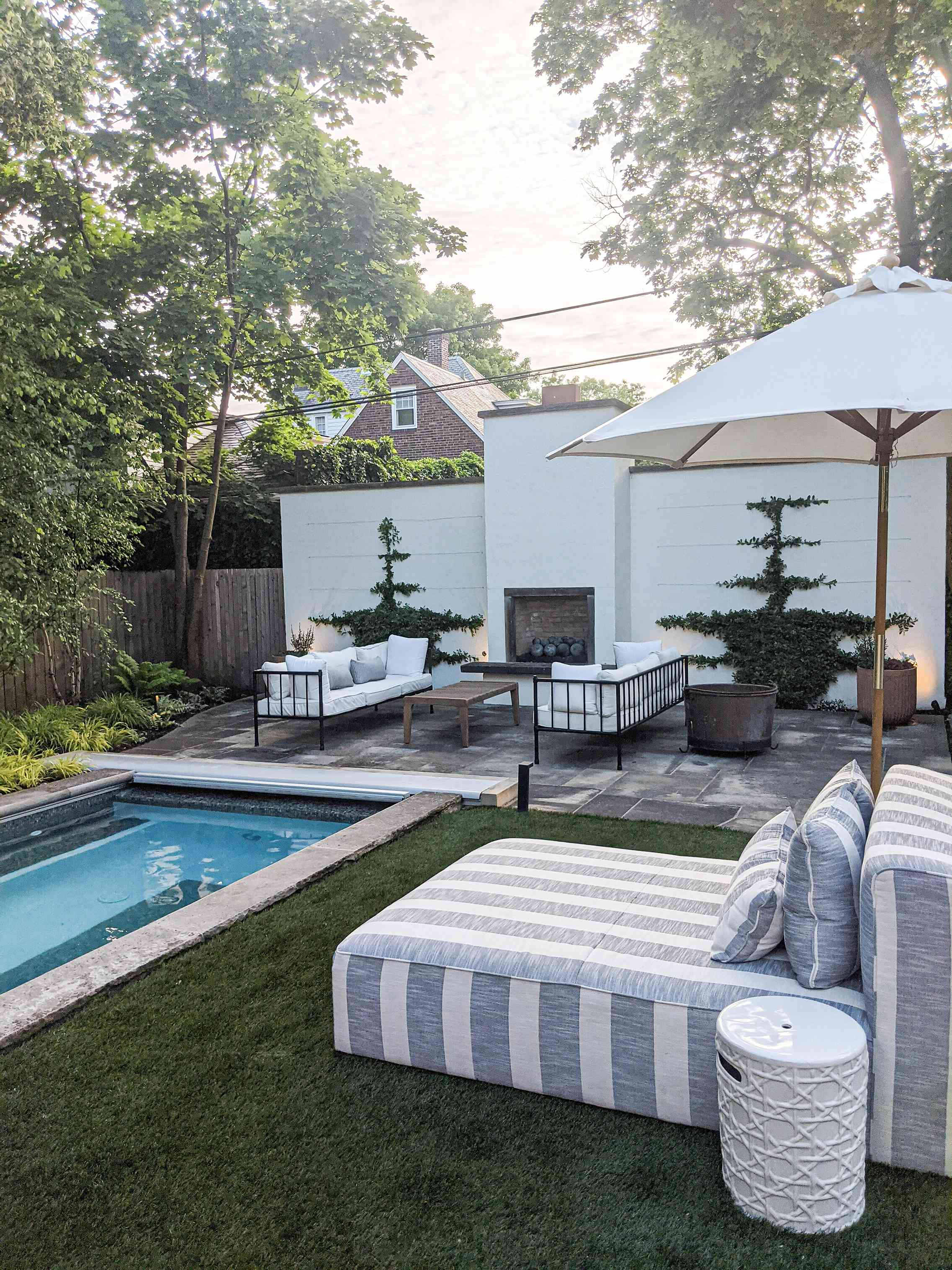 The backyard of Molly & Fritz features a pool-hottub hybrid