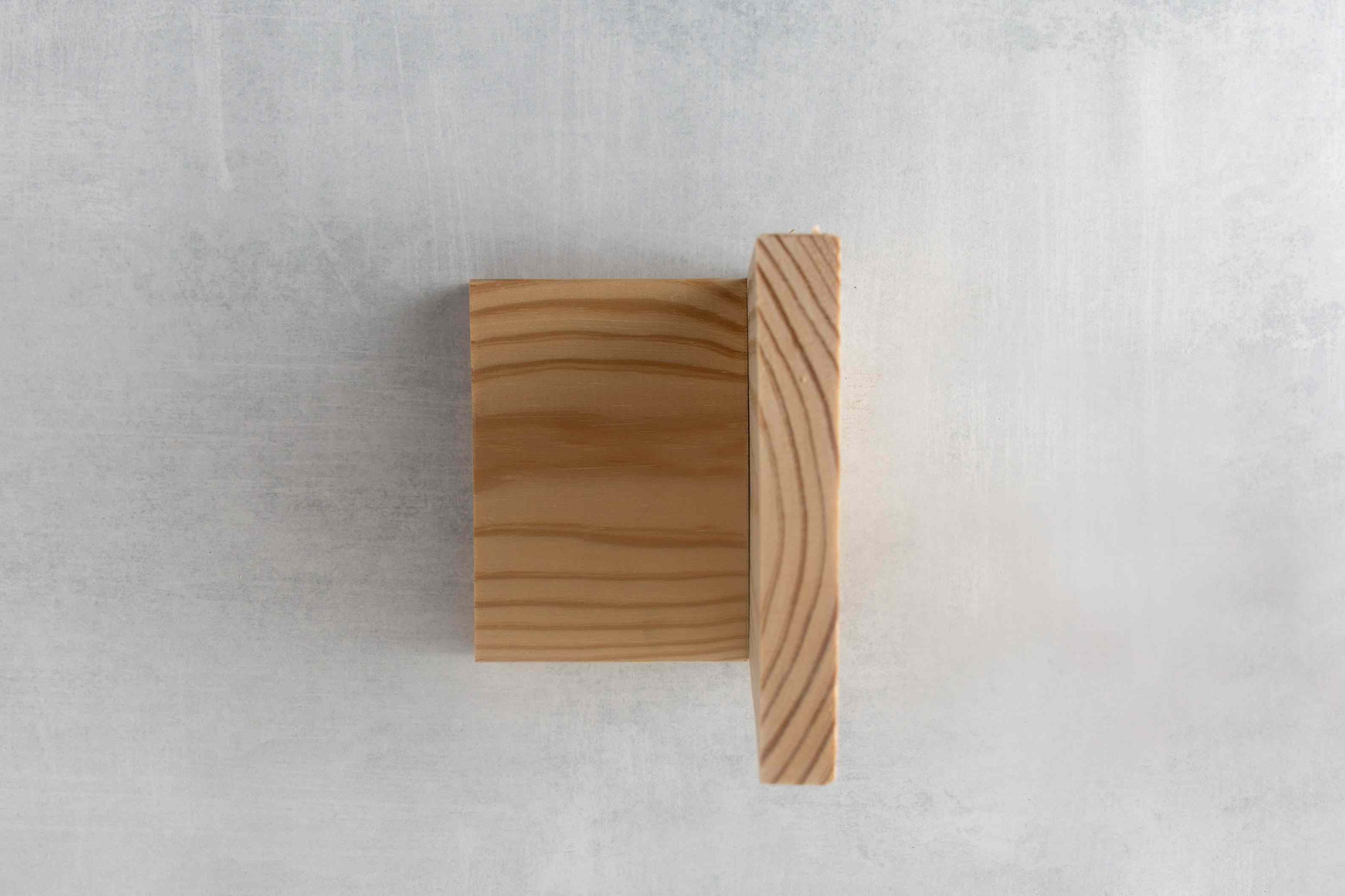 Two pine boards perpendicular to each other.