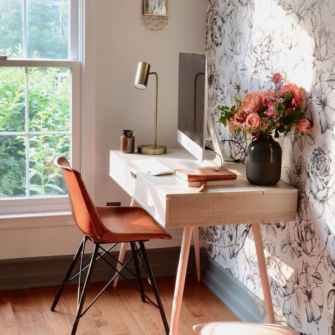 Wooden desk with floral wallpaper