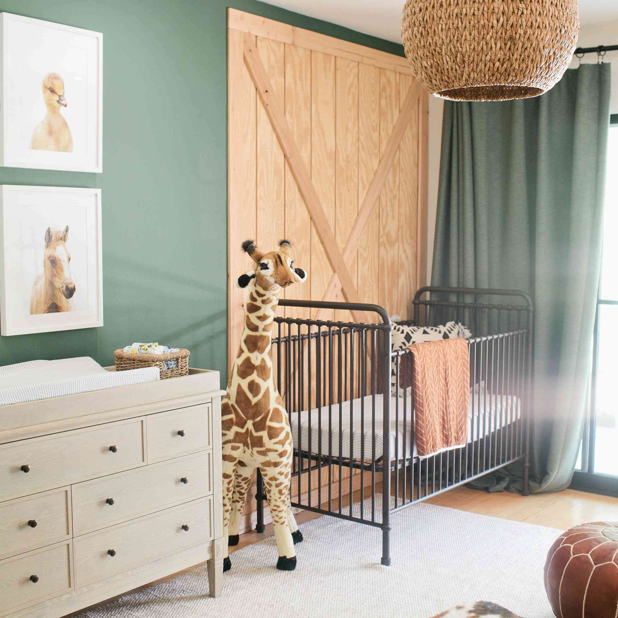 Animal-themed nursery with green walls and natural accents