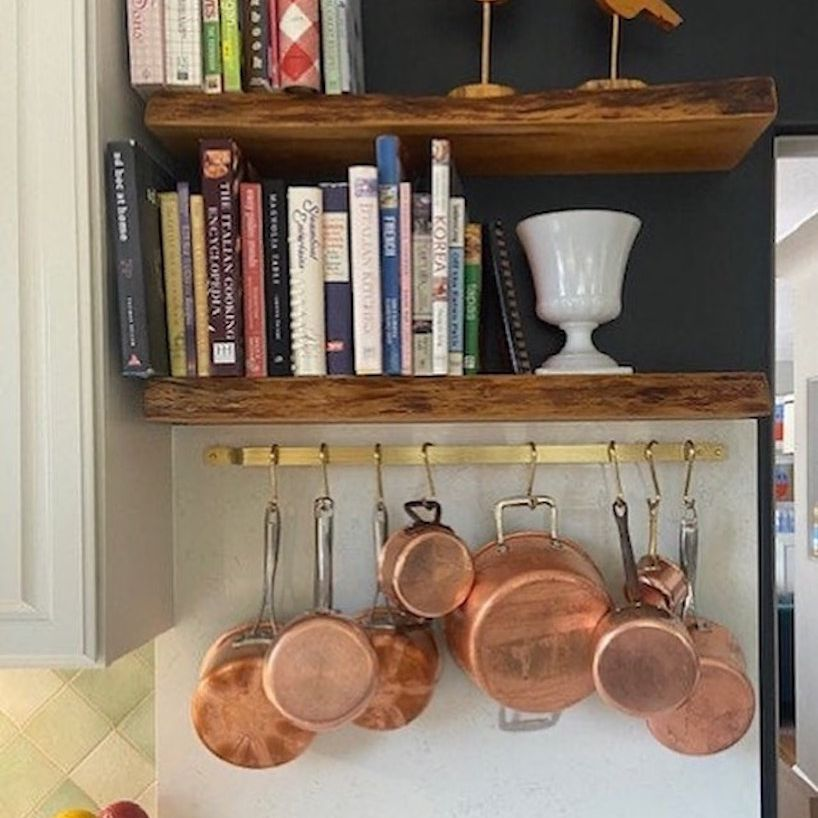 Rail with hanging copper pots