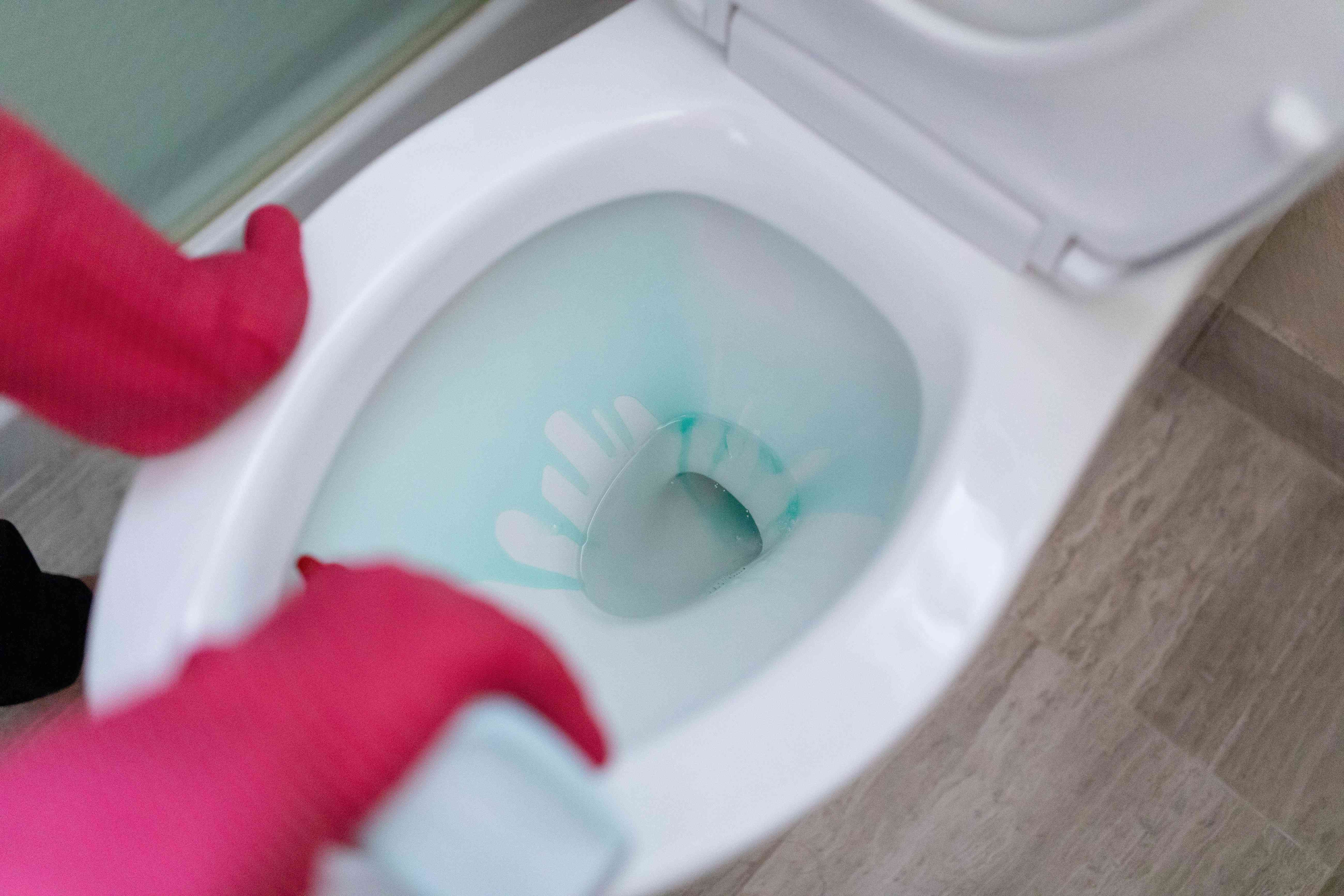 Add cleaning solution to the toilet bowl before flushing