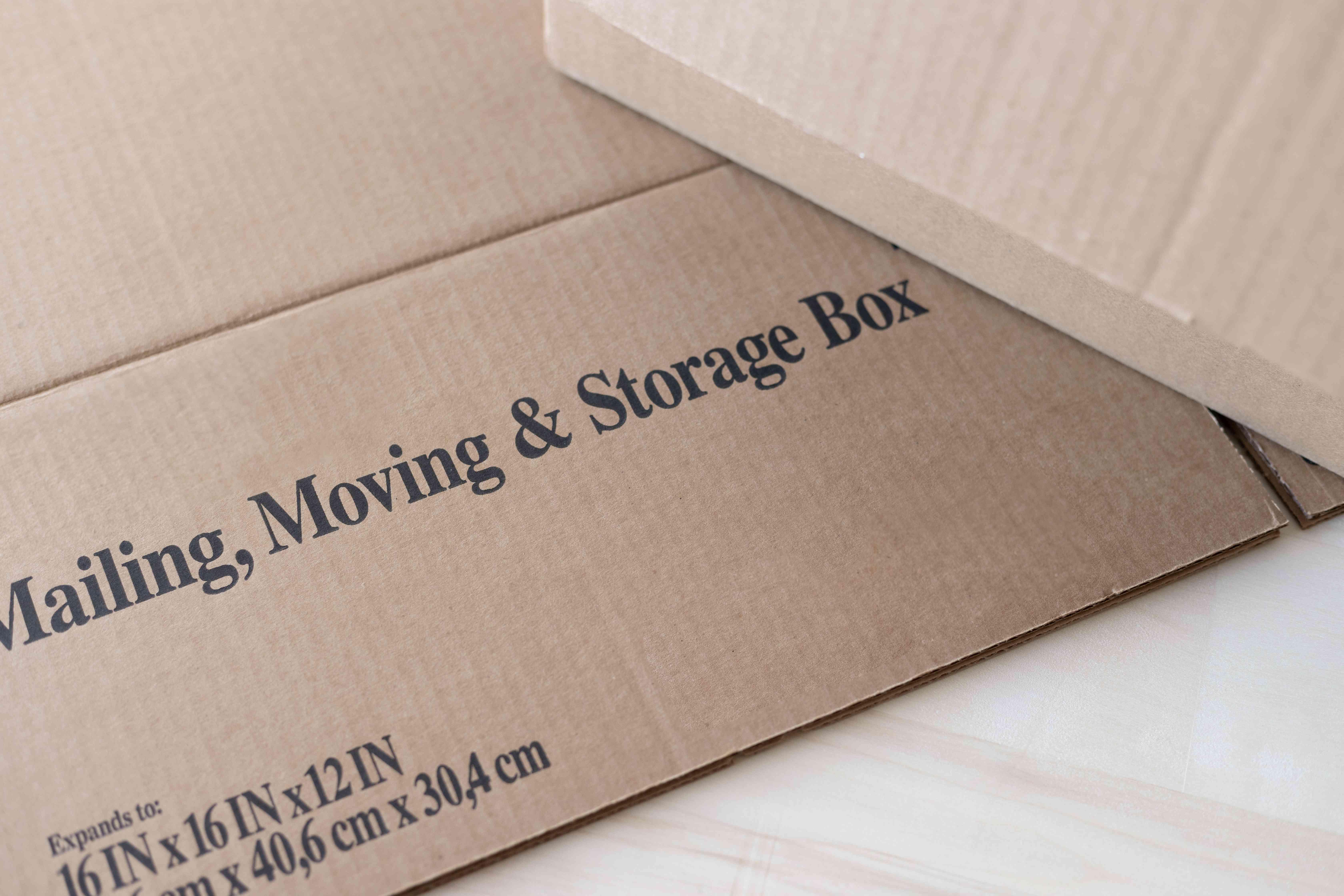 Cardboard box with moving box label closeup