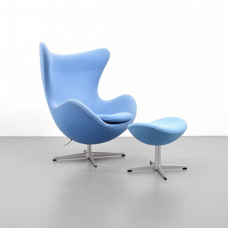 Contemporary version of the Arne Jacobsen Egg Chair and matching footstool with Fritz Hansen label.