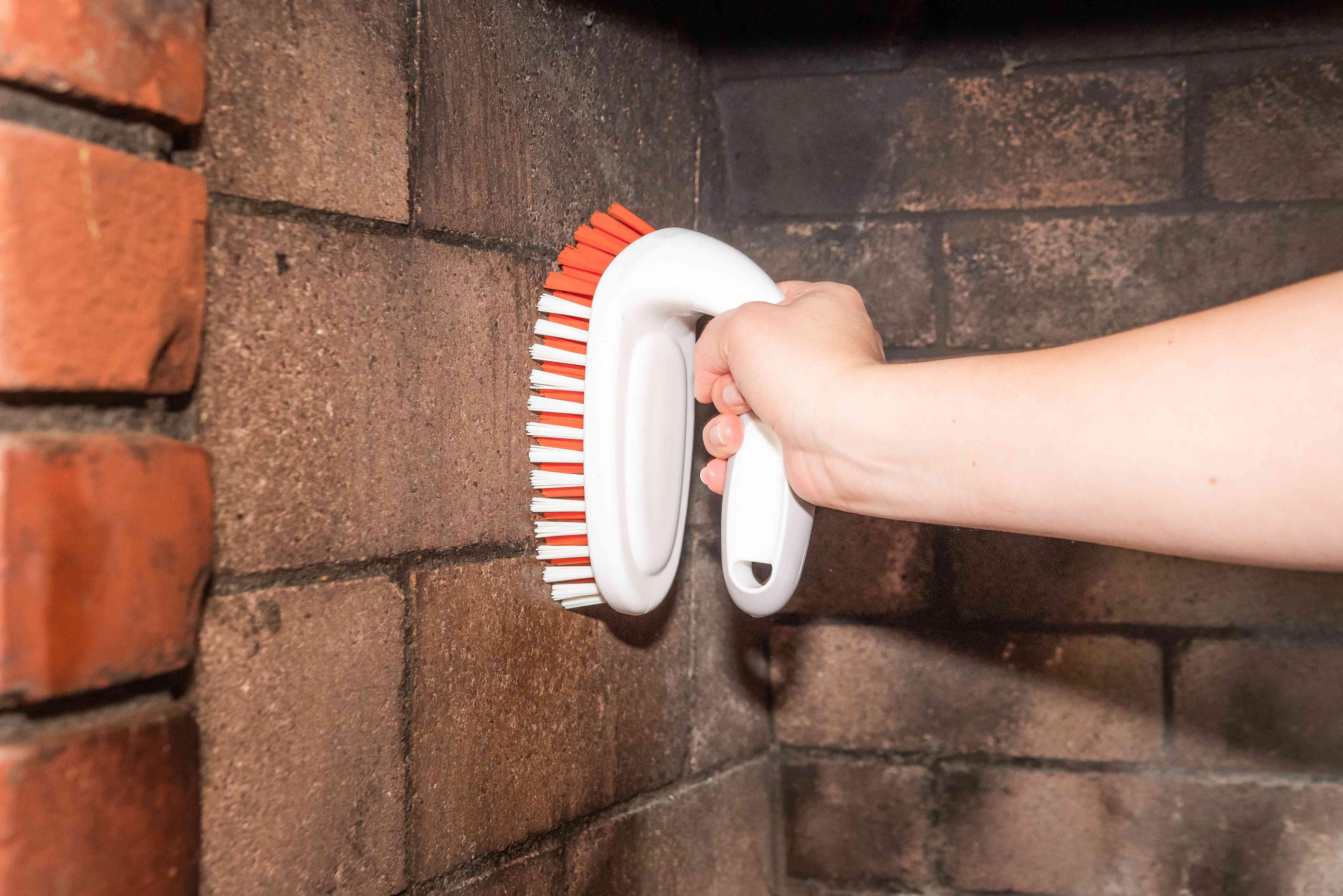 Scrub brush rubbing against fireplace walls