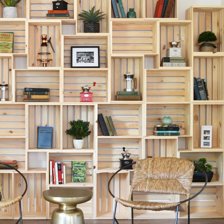 Full wall of wooden crate built ins