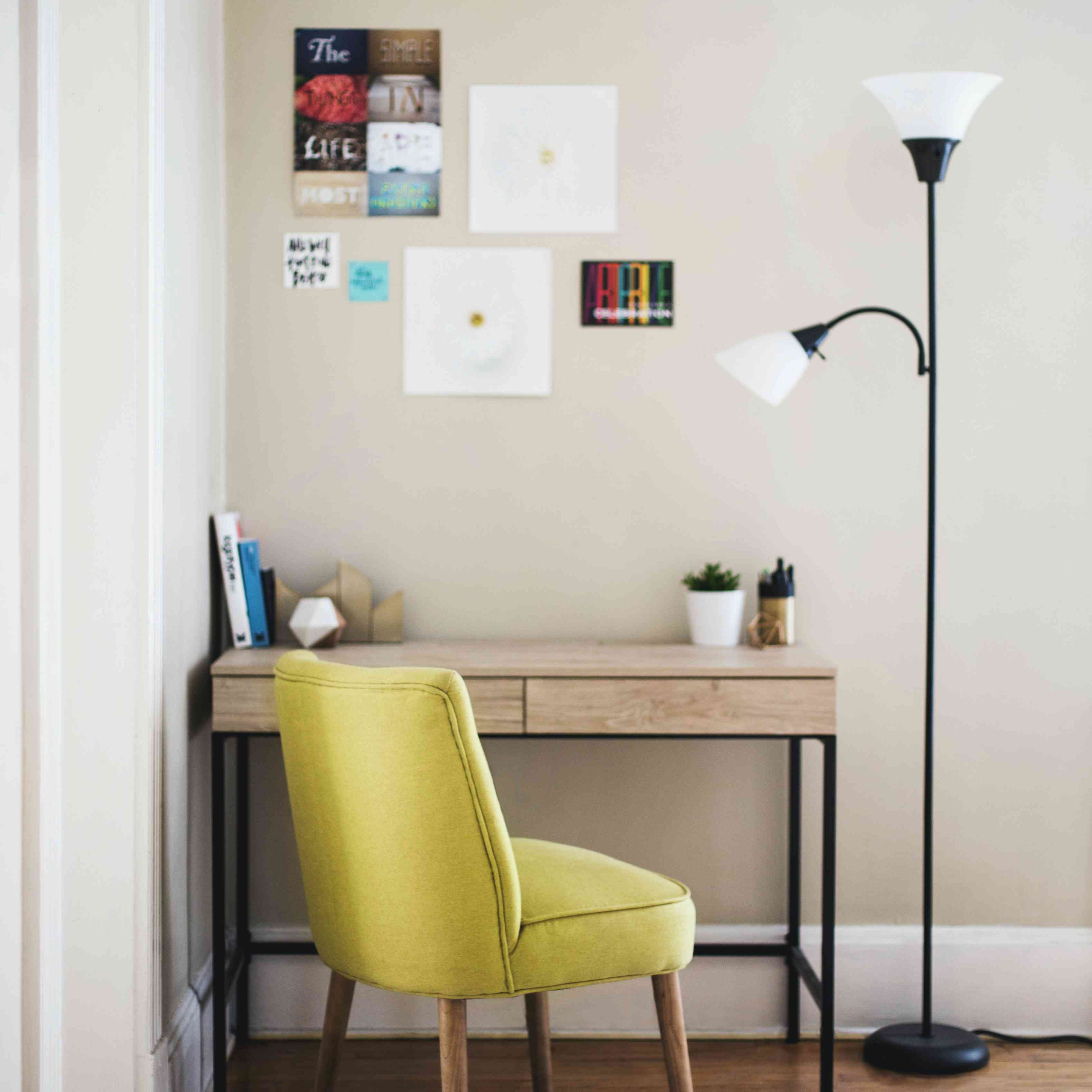 Corner home office space with yellow chair