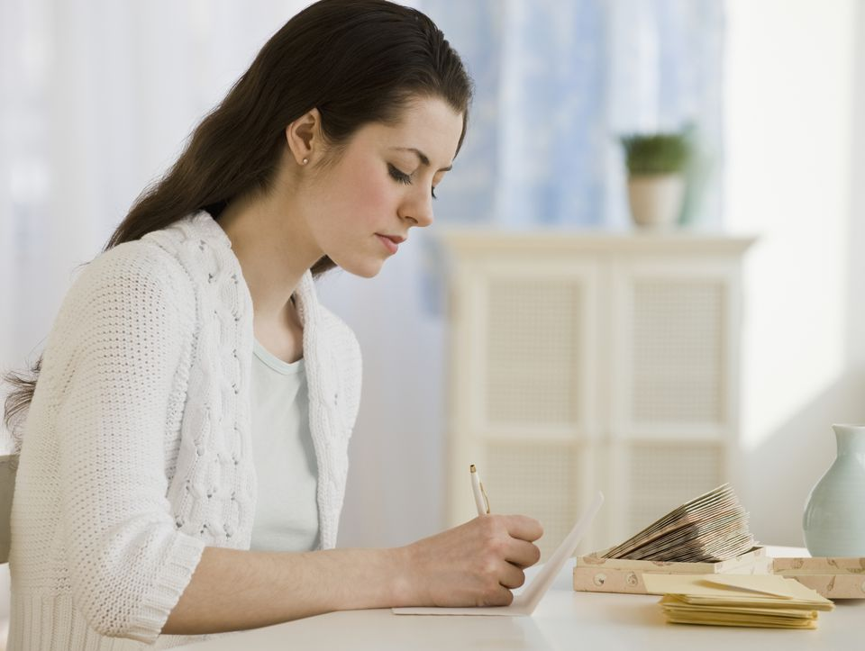 Woman writing a thank you note