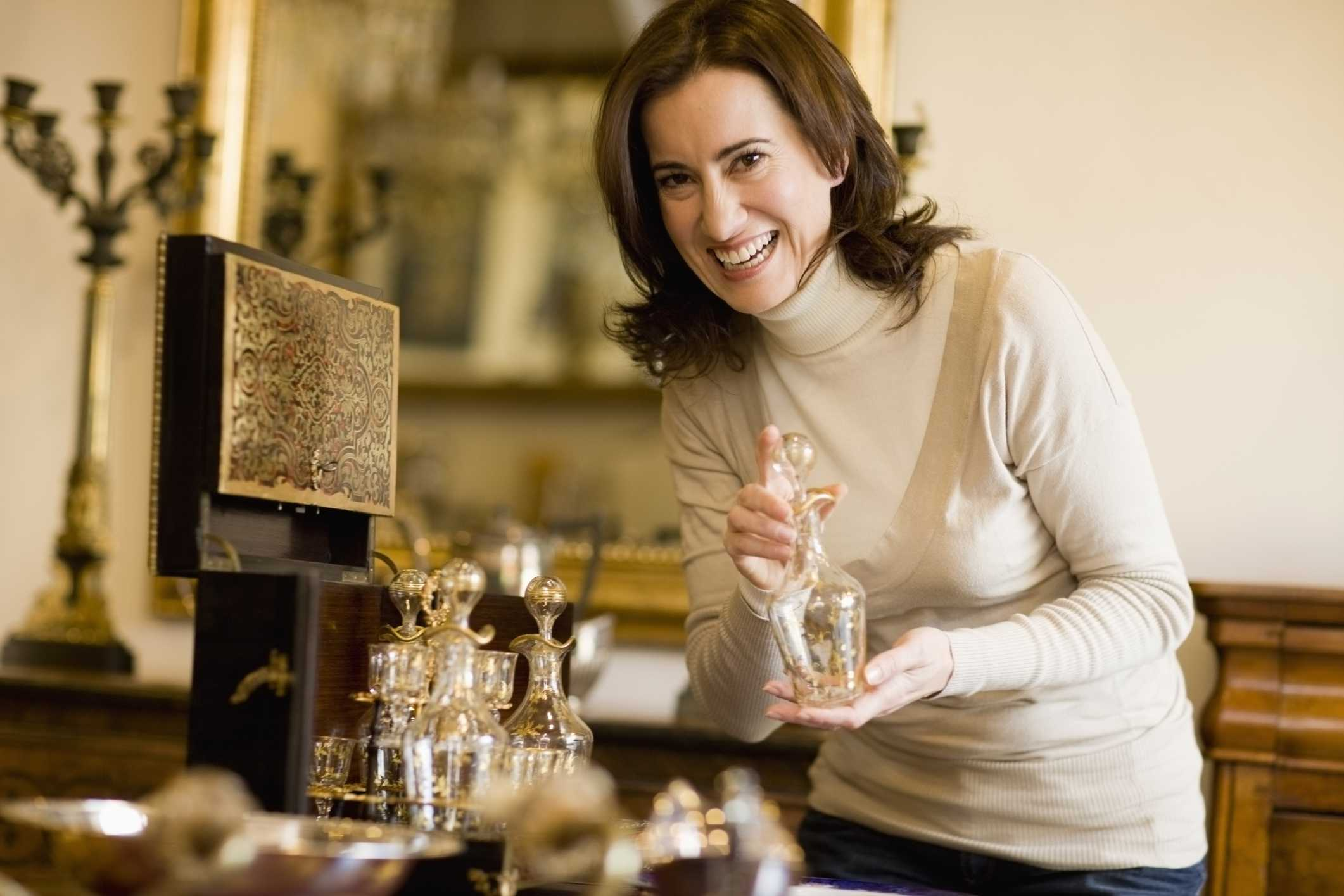 woman browsing antiques at an estate sale