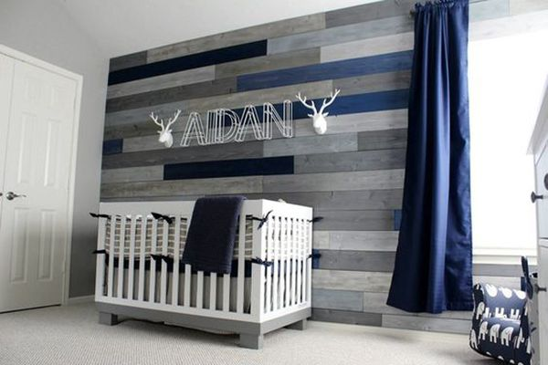 Navy and grey nursery with rustic accent wall