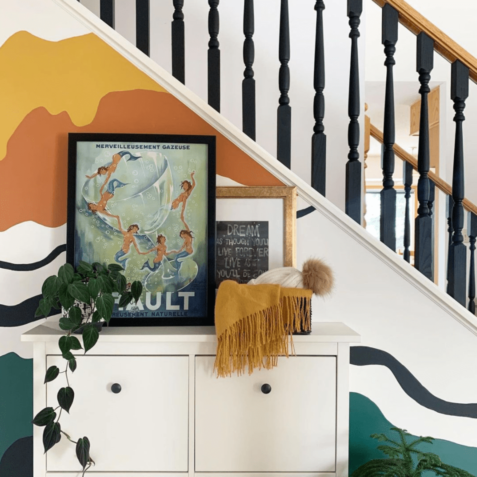 A painted mural on a staircase.