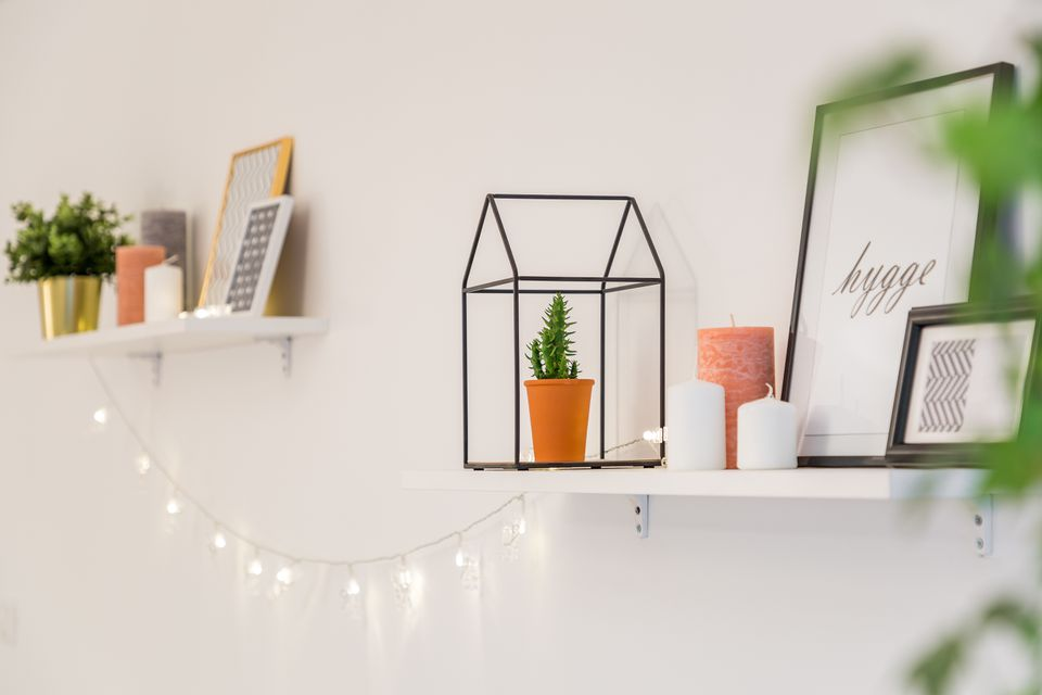 Shelves with quaint and minimalist decorations