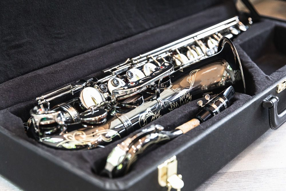 Saxophone musical instrument in black case to be sold for cash