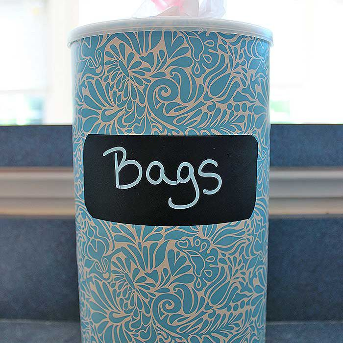 Plastic bag storage container with blue and cream pattern