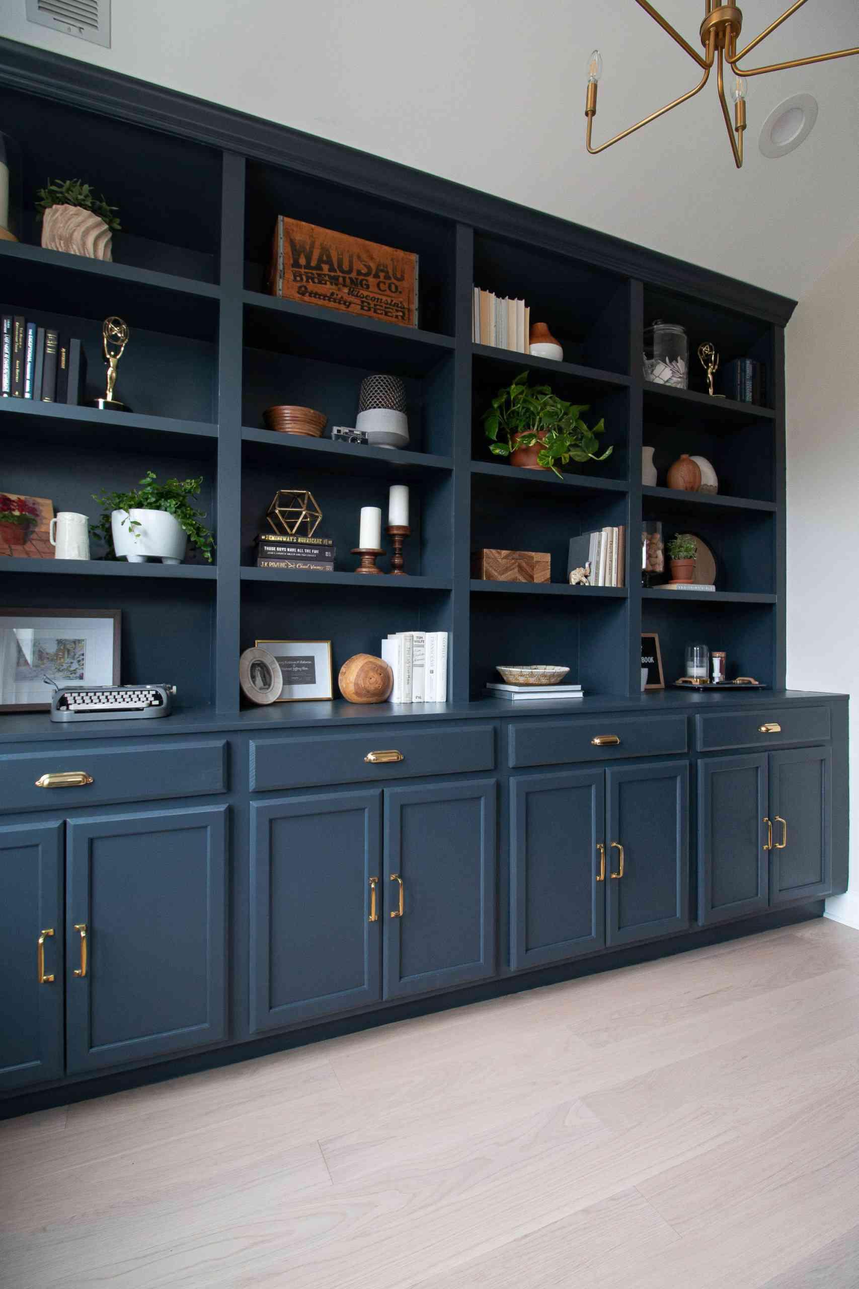 Dark blue bookshelves