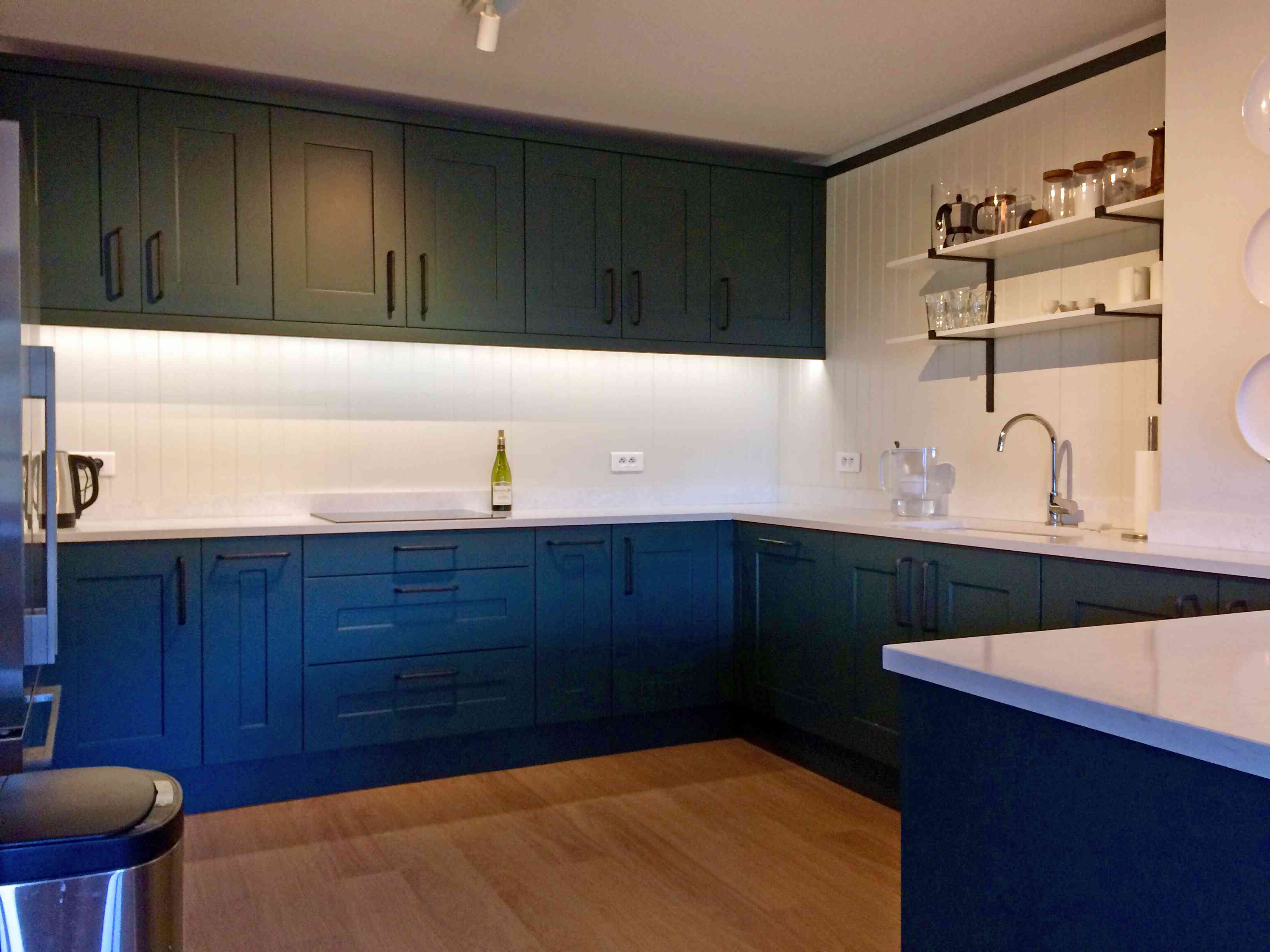 green and blue kitchen cabinets