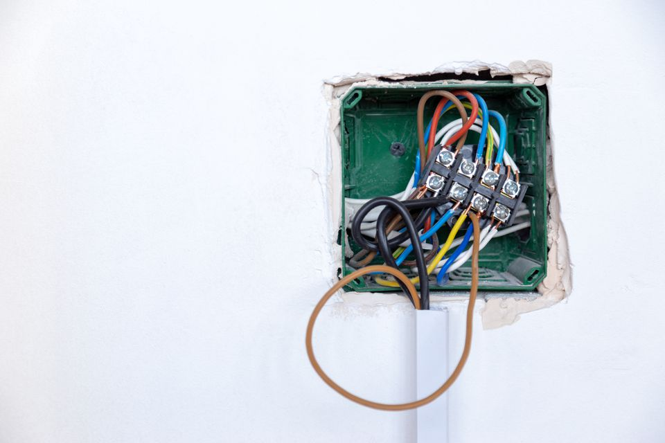 Electrical wiring connection box. attaching new unplanned wire to a box. Handyman concept.