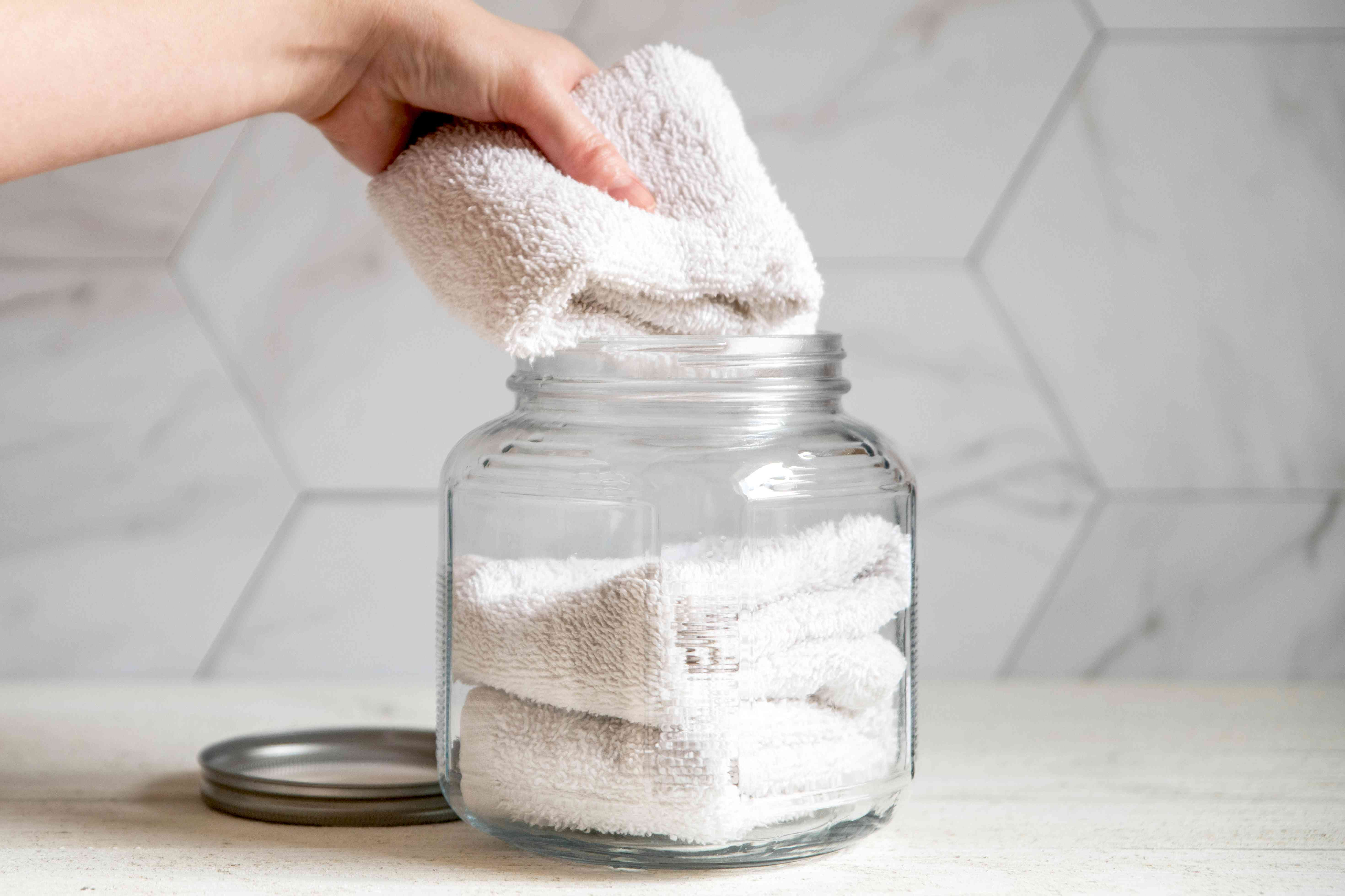 Folded cloth placed back in glass jar