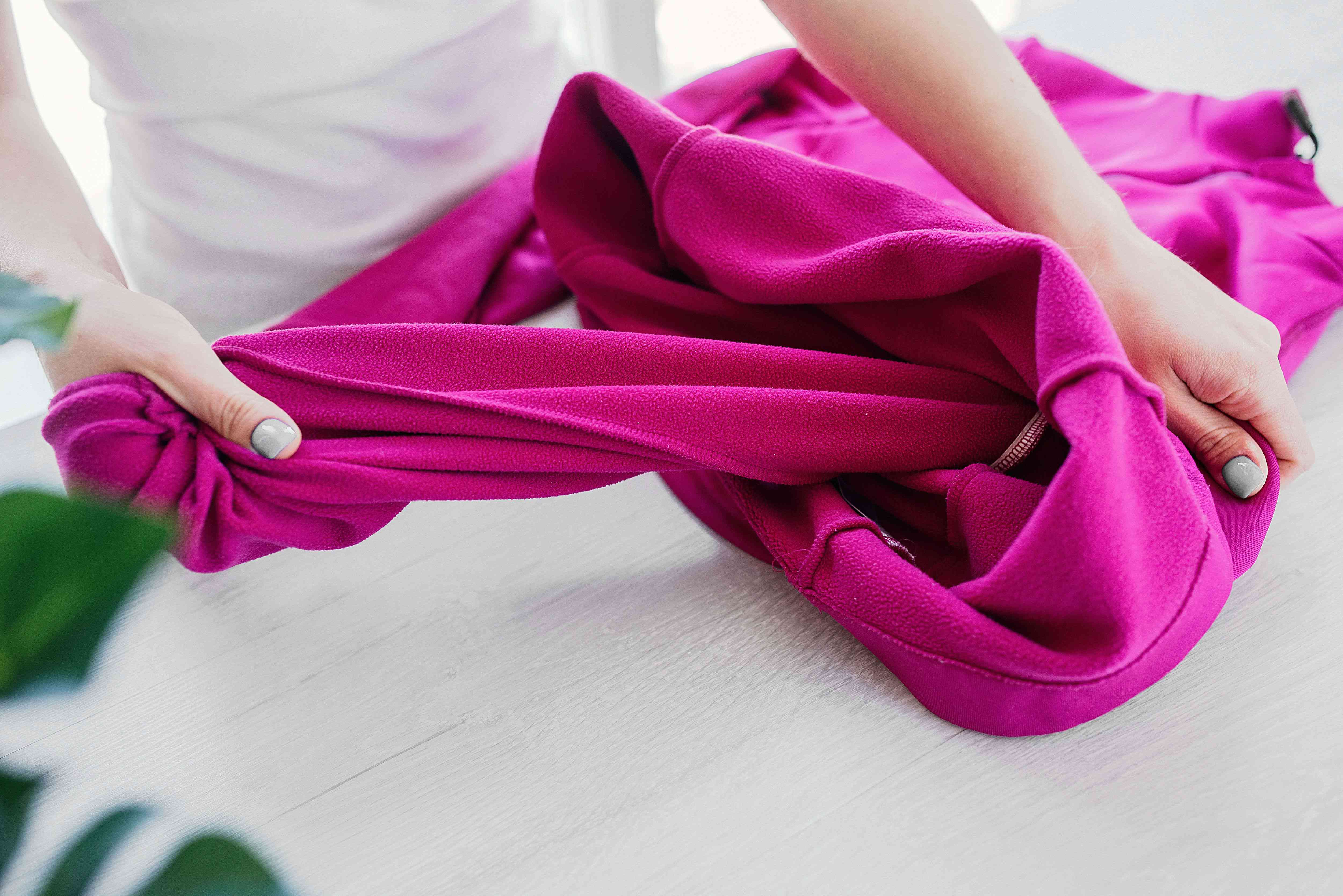 Sorting laundry and turning the fleece garment inside out