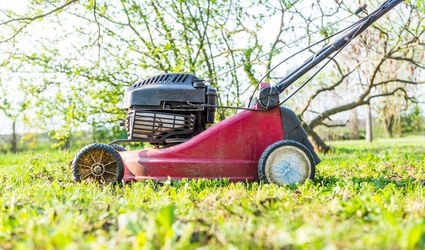 Close-Up Of Lawn Mower On Field