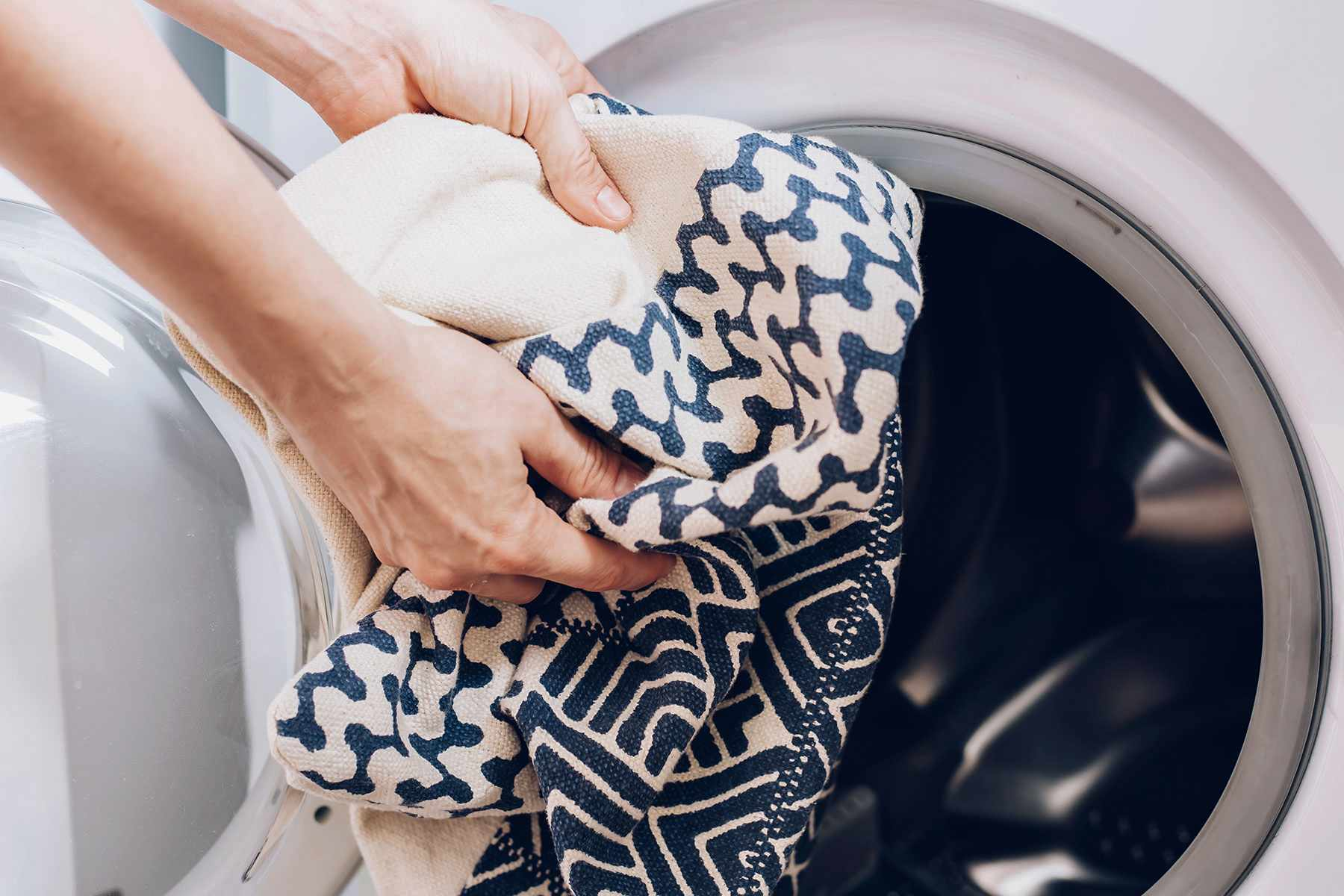 putting washable items into the washer