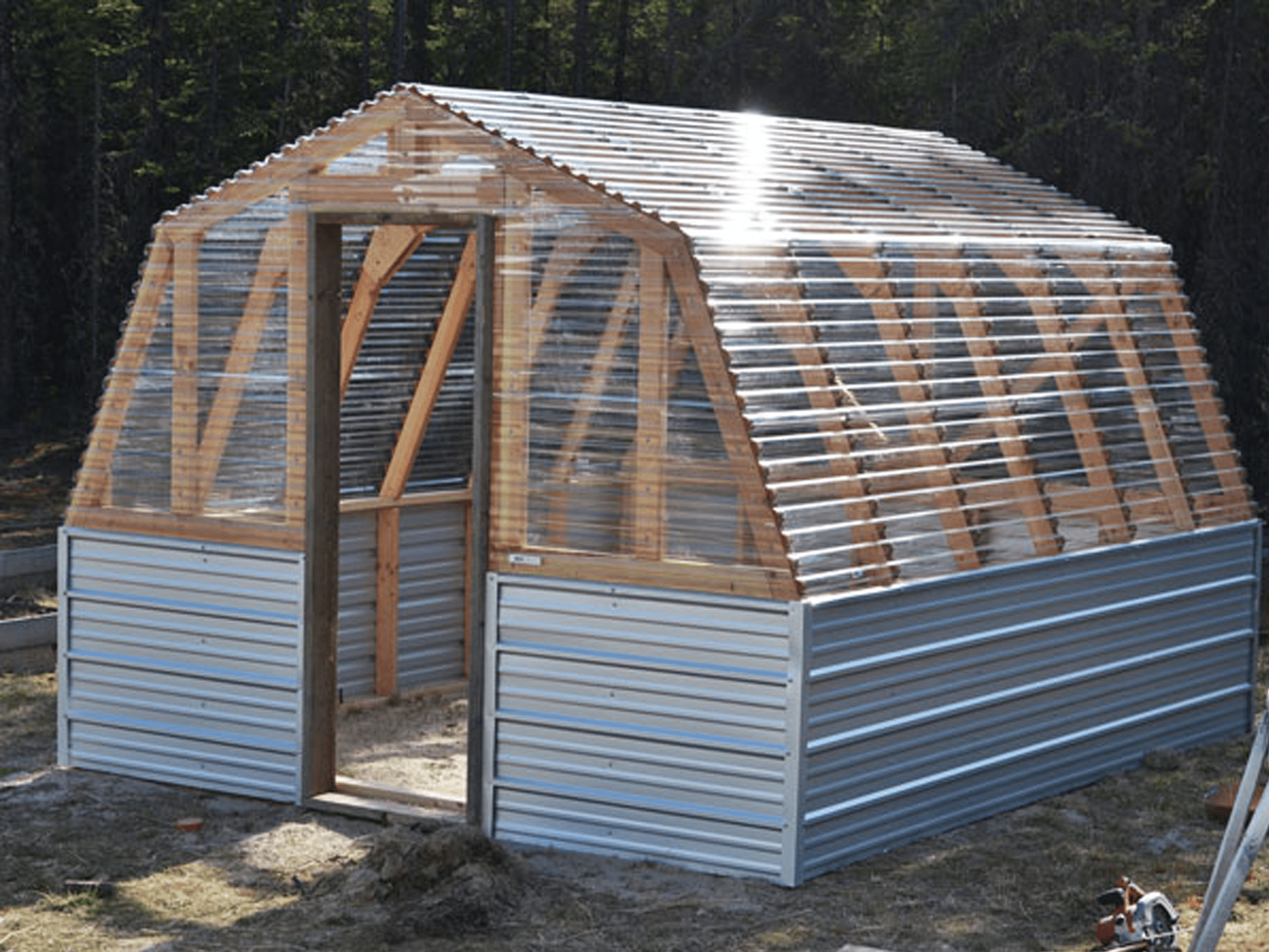 Completed barn greenhouse with clear roofline.