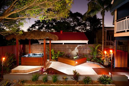 Covered Patio With Hot Tub At Night