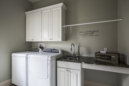 Washing Machine Dryer And Sink In Laundry Room