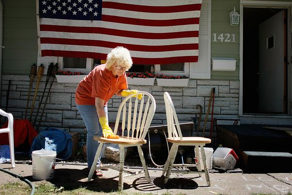 A woman cleaning wooden furniture