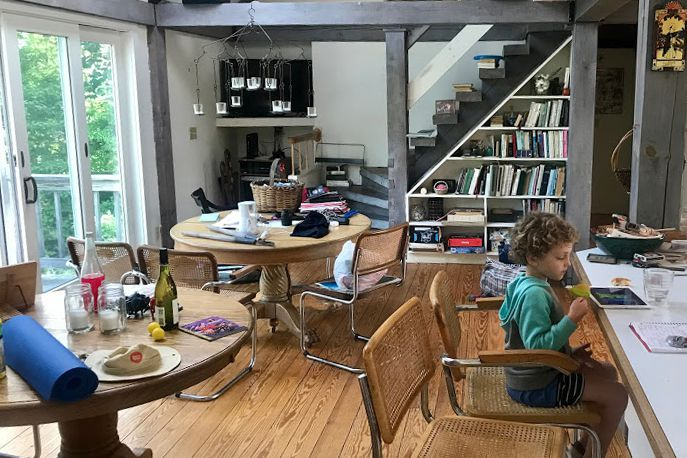 Boy plays on iPad during renovation of the Cap Cod home