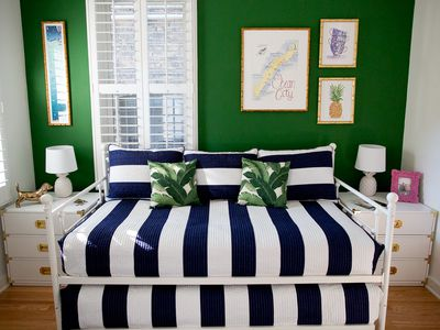 Green and navy themed bedroom