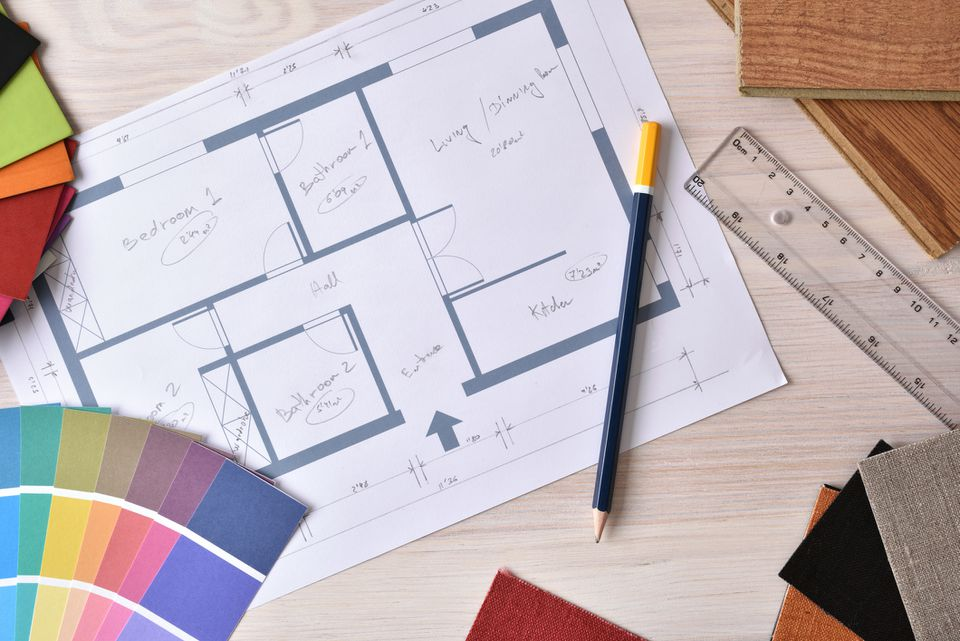 Decorator workbench with home plan on wooden table top