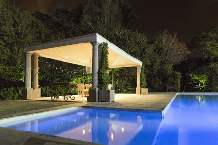 Illuminated gazebo at poolside - What Is A Pergola And How Does It Differ From An Arbor?