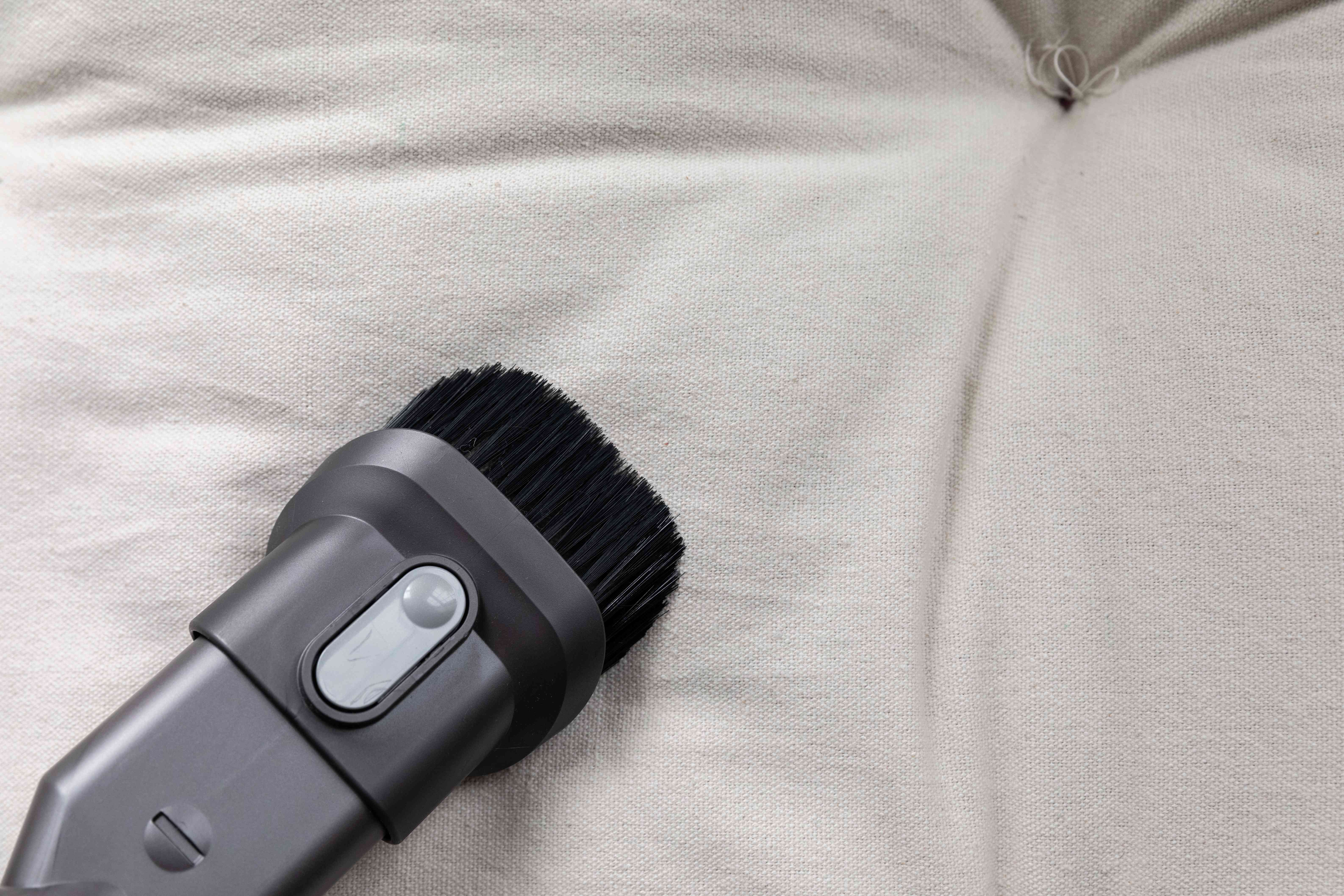 vacuuming the upholstery after stain removal