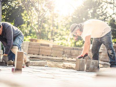 Men installing paving stones