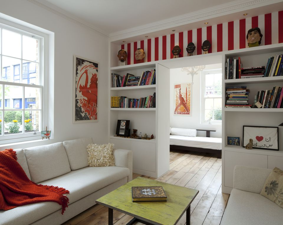 Sofas and built in shelving in modern sitting room, London, UK.