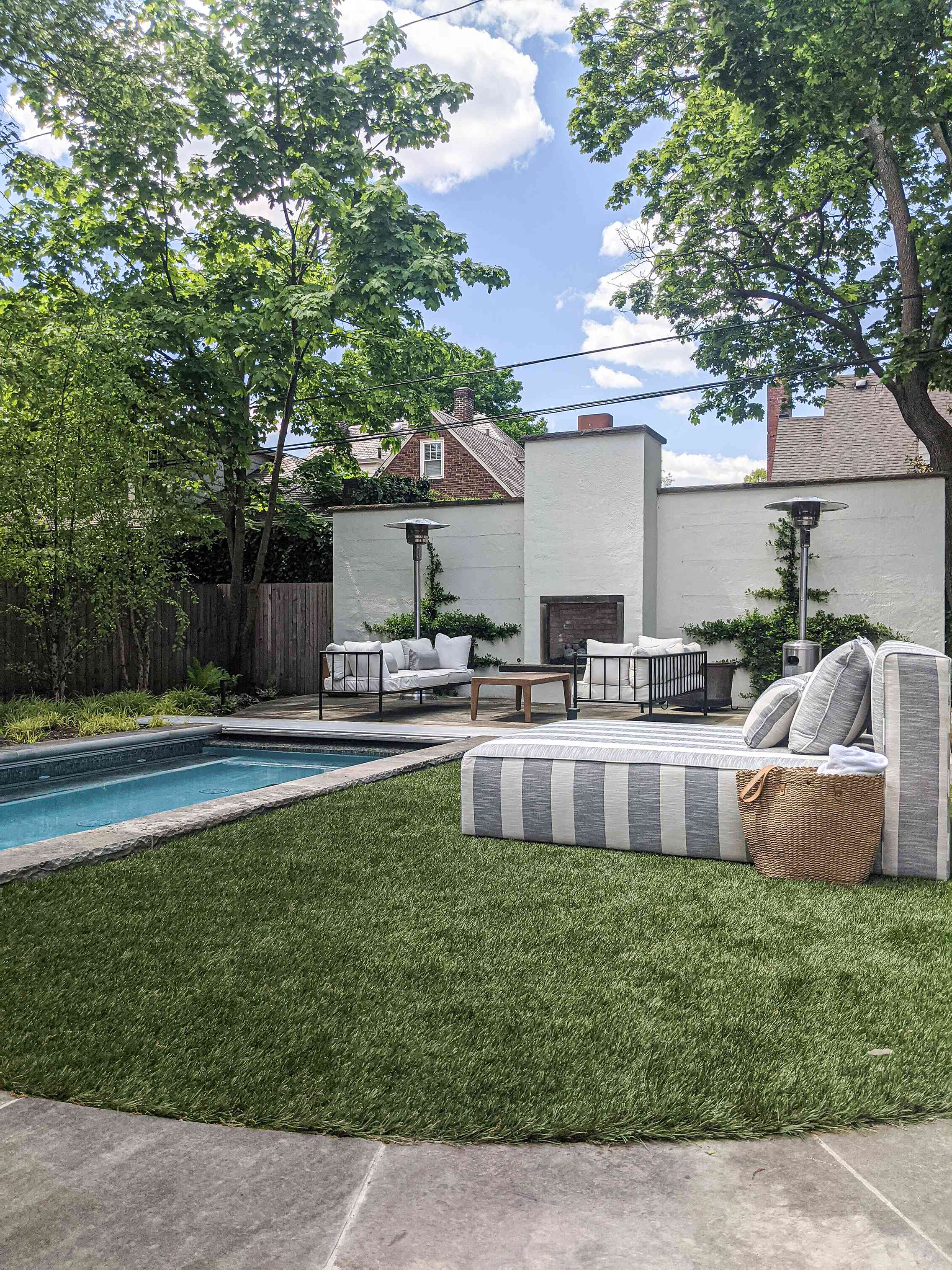 The backyard of Molly and Fritz features a pool, a cedar patio and a grassy area