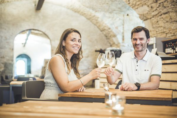Couple toasing in a wine cellar