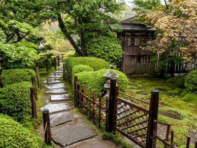 Japanese garden with stone walkways.