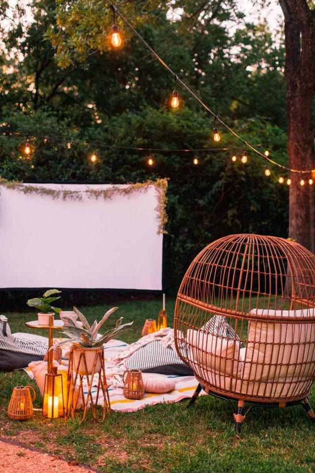 A backyard movie with chairs and a screen