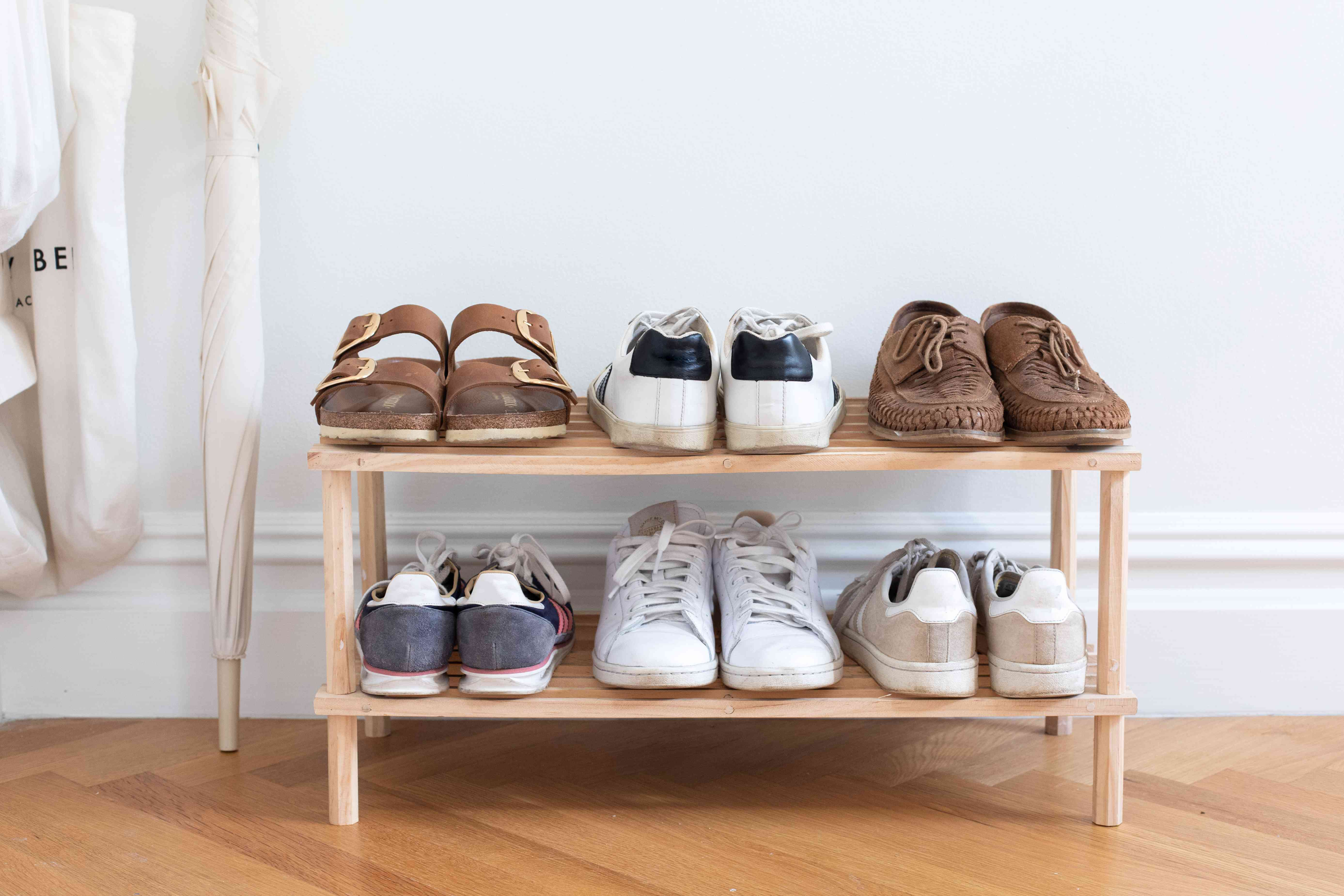 frequently worn shoes on a rack near an entryway point