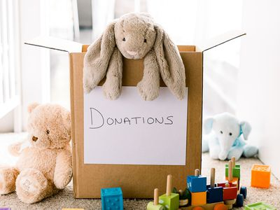 toys in and around a donation box