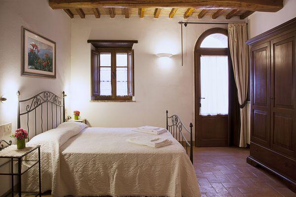 Interior shot of Tuscan bedroom