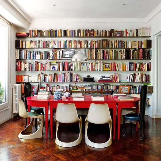 Bright red table in a home library