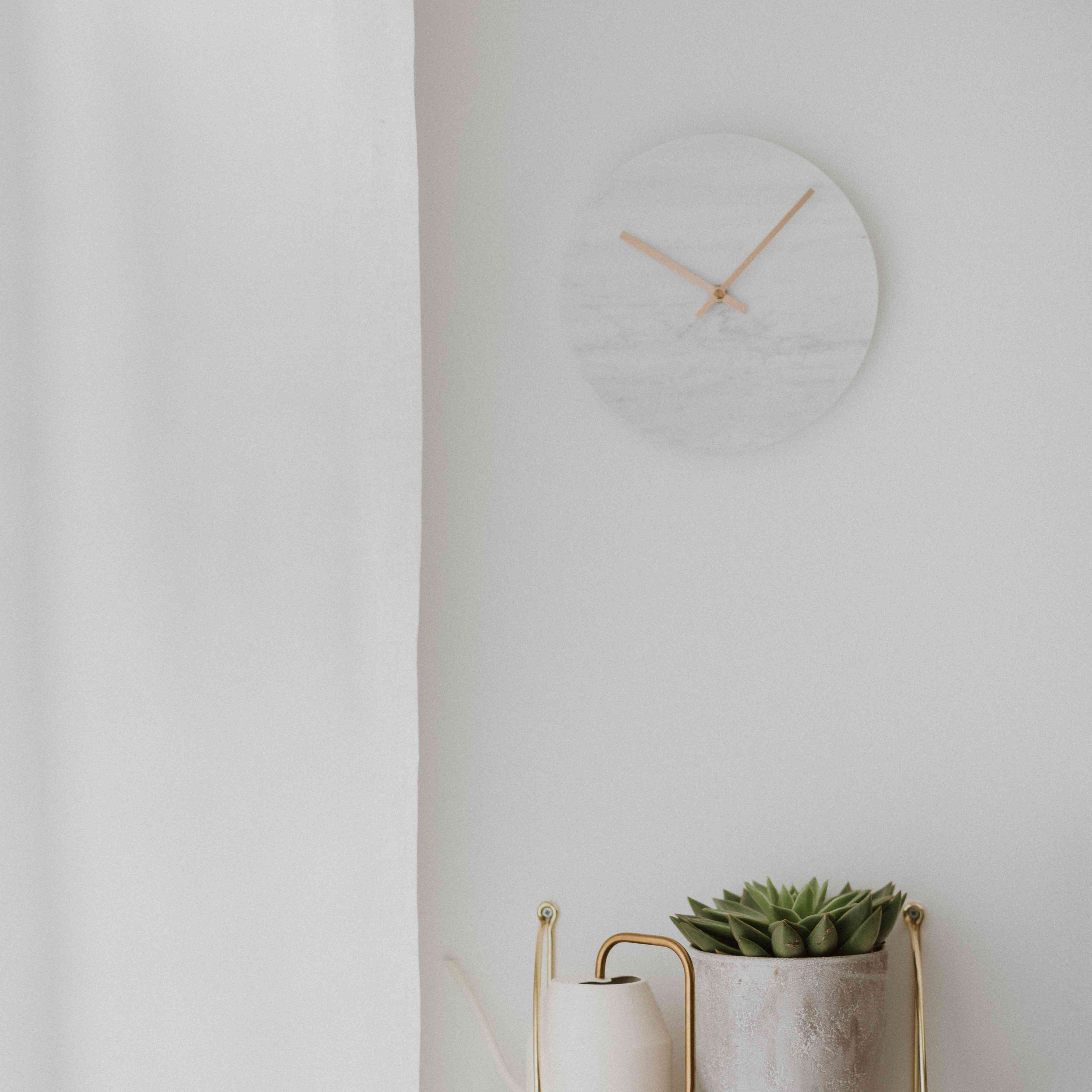 gray, white and metallic accents with a clock, planter and drape