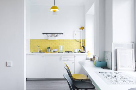 Yellow Subway Tile Backsplash In Kitchen